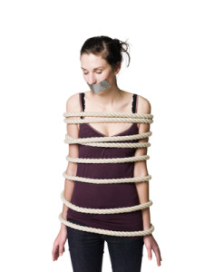 Tied up woman with tape over her mouth